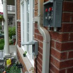 The exterior disconnect switch, and the new second meter housing on the front of the house.