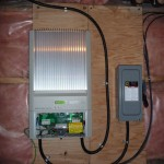 The solar inverter (left) and disconnect switch (right), now connected to the rest of the system with teck cable.