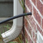 Closeup of the cable going into the house.