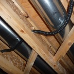 Teck cable fed through the basement ceiling beams.