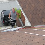 Sliding a panel up the roof.